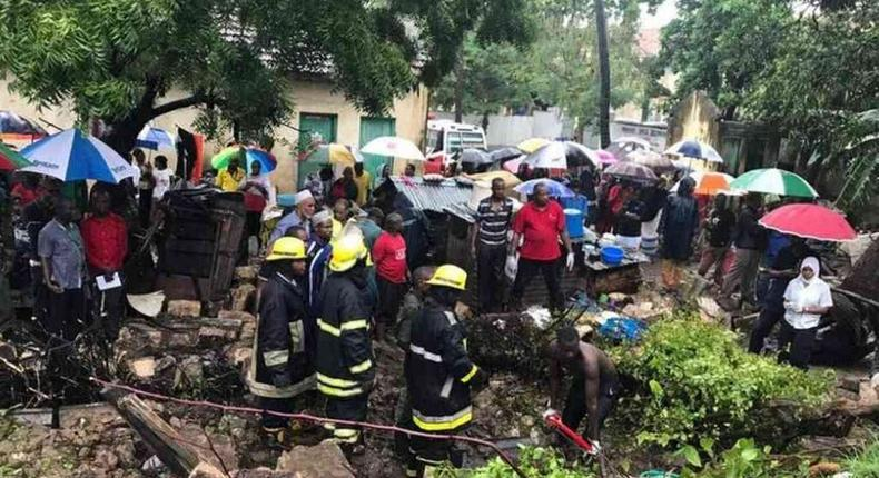 Rescuers pull bodies of people killed after a wall collapsed on a house in Mbaraki, Mombasa, May 8, 2017.