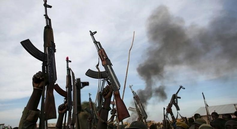 Rebel fighters hold up their rifles in Upper Nile State, South Sudan,  file.   REUTERS/Goran Tomasevic/File Photo