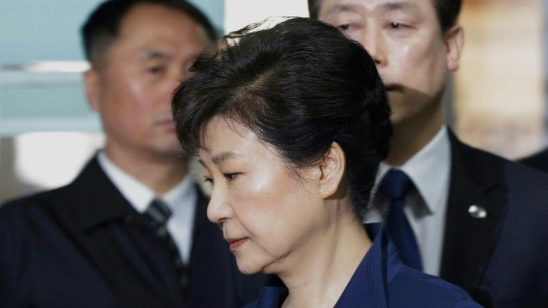 South Korea's ousted president Park Geun-Hye (front) arrives for questioning on her arrest warrant at the Seoul Central District Court in Seoul on March 30, 2017