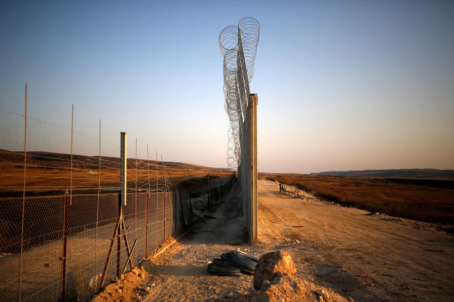 An Israeli barrier with the West Bank is seen while still under construction near Havat Ela in south