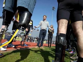 Britain's Prince Harry Patron of the Invictus Games Foundation, speaks to competitors as he attends