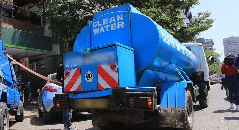 A water bowser delivers water in the city centre