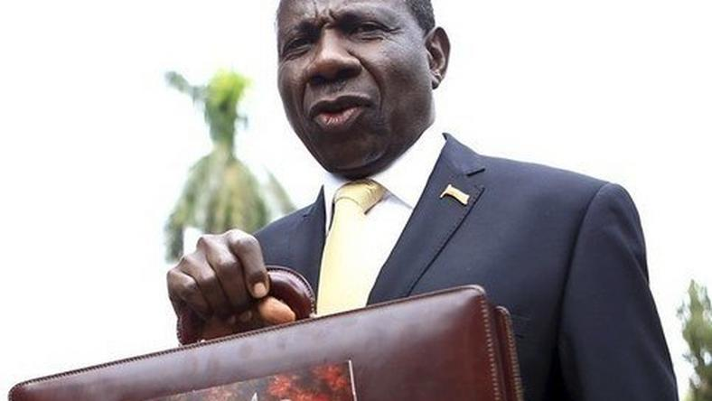 Uganda Minister of Finance Matia Kasaija displays a briefcase carrying national budget before presenting it to the nation during a budget speech in Uganda's capital Kampala, June 11, 2015. REUTERS/James Akena