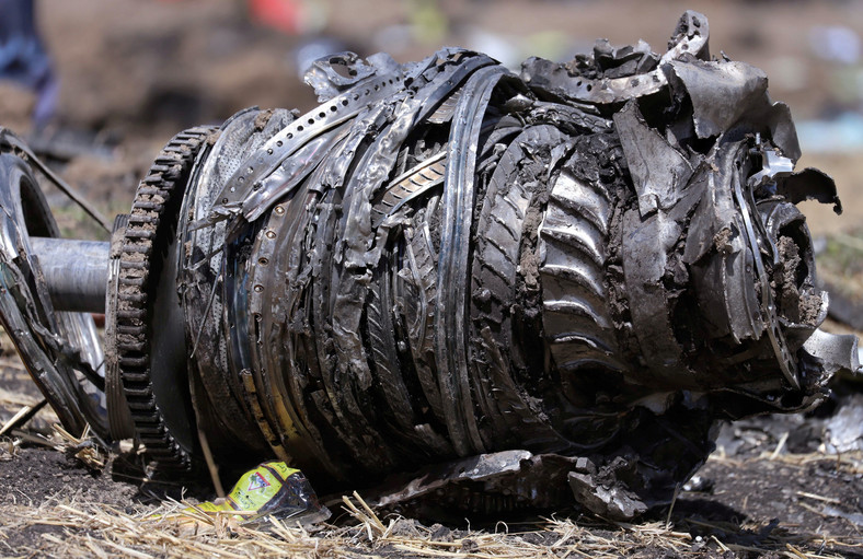 Airplane engine parts are seen at the scene of the Ethiopian Airlines Flight ET 302 plane crash, near the town of Bishoftu.