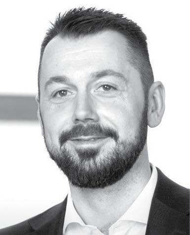Maciej Guzek doradca podatkowy i partner w Deloitte