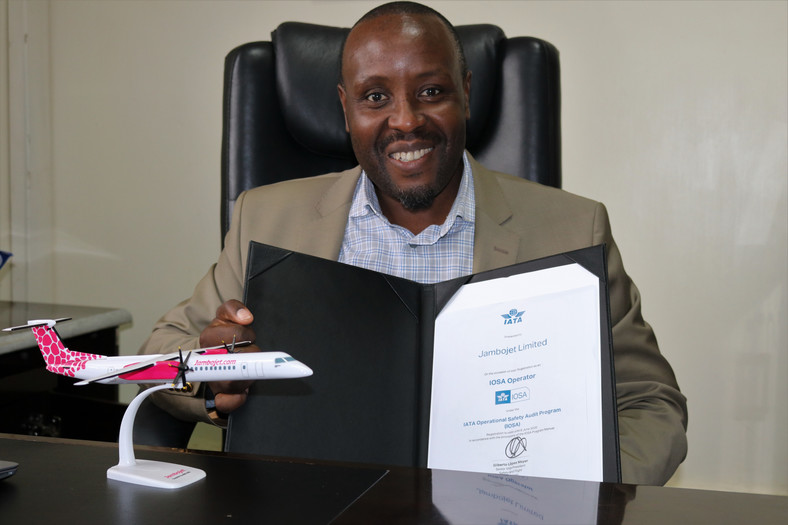 Jambojet CEO Allan Kilavuka holding the certificate.