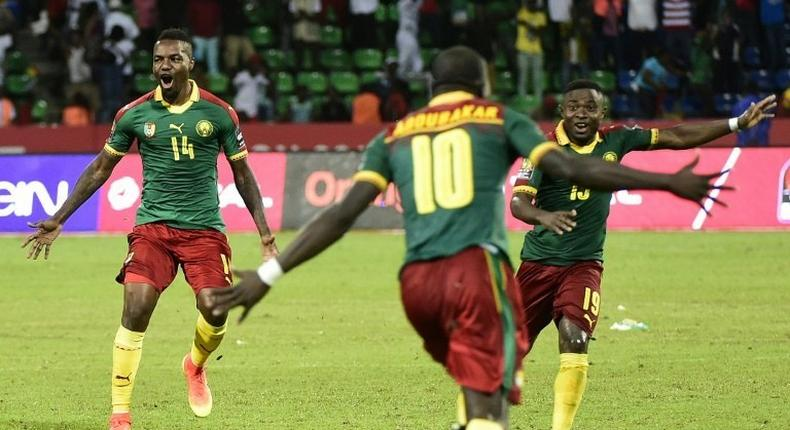 Cameroon's players celebrate after winning the penalty shootout at the end of their 2017 Africa Cup of Nations quarter-final match against Senegal, in Franceville, on January 28, 2017