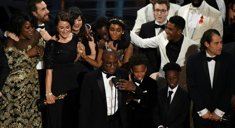 US director Barry Jenkins (C) speaks after Moonlight won the Best Film award at the 89th Oscars on February 26, 2017 in Hollywood, California