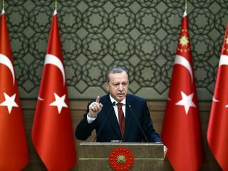 Turkish President Tayyip Erdogan makes a speech during his meeting with mukhtars at the Presidential