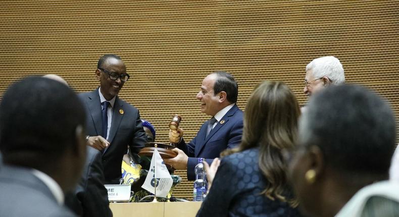 Paul Kagame handing over baton  to Abdelfattah Elsisi as new AU Chair