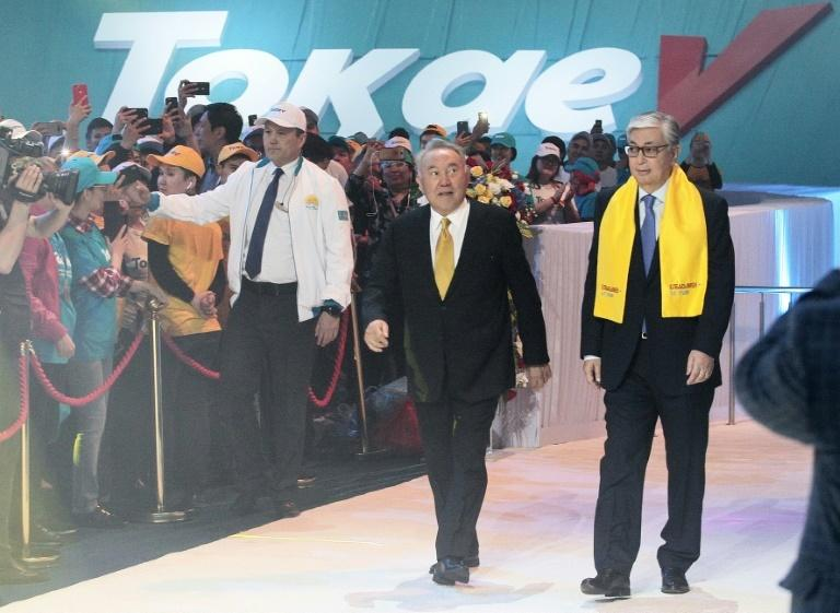 Nazarbayev (C) announced in March that he was stepping down and named Tokayev (R) as interim leader