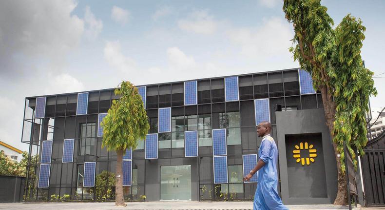 Passerby walks through Rensource Office in Lagos