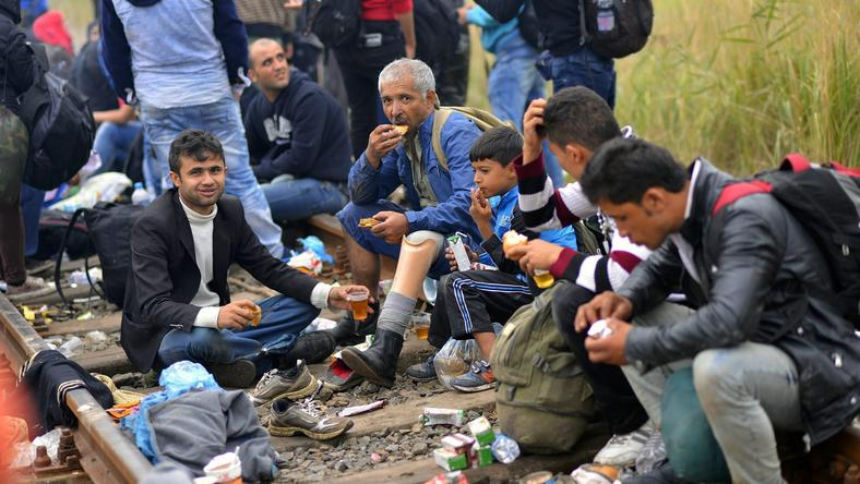 HUNGARY MIGRATION REFUGEES CRISIS (Migrants wait at a collection point in Roszke)