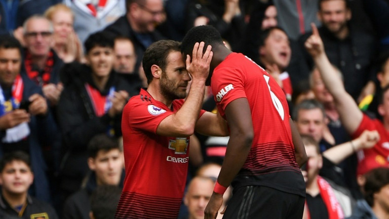 Positive Pogba: Juan Mata (left) believes Paul Pogba (right) remains a positive influence for Manchester United