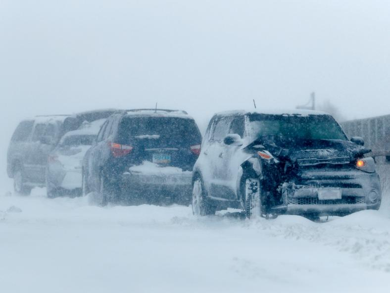 A string of wrecked vehicles sit on an overpass over Interstate 70 as a late winter storm packing hurricane-force winds and snow sweeps over the intermountain West Wednesday, March 13, 2019, in Aurora, Colo. (AP Photo/David Zalubowski)