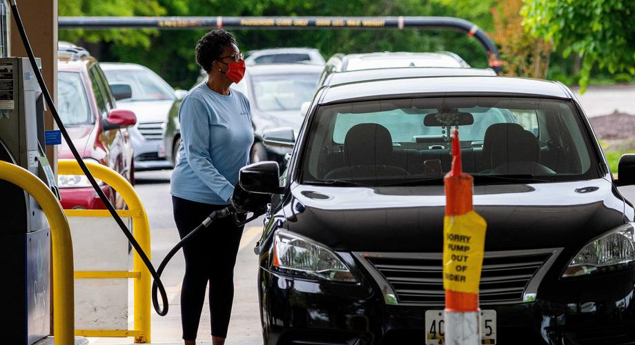 Stock image of a woman filling her car with fuel