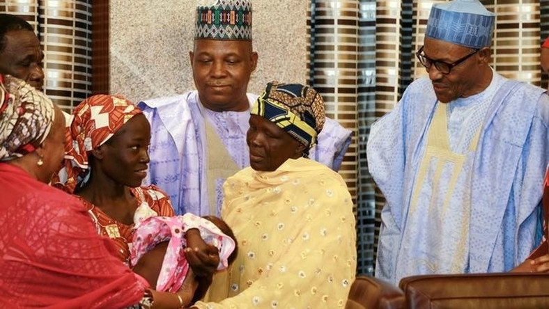 Amina Ali Darsha Nkeki, a Nigerian schoolgirl rescued after over two years of captivity with BokoHaram militants, presents her child to President Muhammadu Buhari in Abuja, Nigeria May 19, 2016.