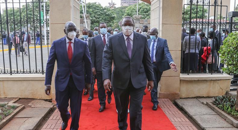 President Uhuru Kenyatta with his deputy William Ruto during the 2021 National Prayer Breakfast at Parliament buildings