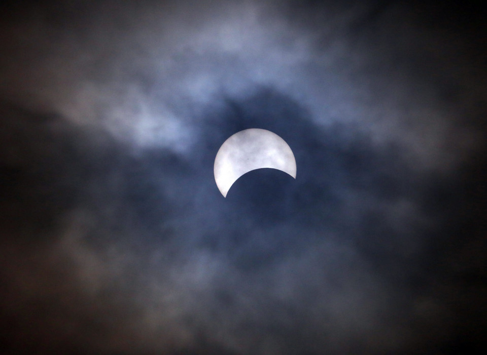 PHILIPPINES SOLAR ECLIPSE (Partial solar eclipse visable on a cloudy morning in Manila)