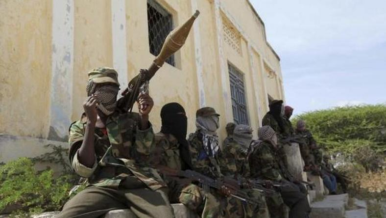 Al Shabaab soldiers sit outside a building during patrol along the streets of Dayniile district in Southern Mogadishu, March 5, 2012. Photo Credit: Reuters
