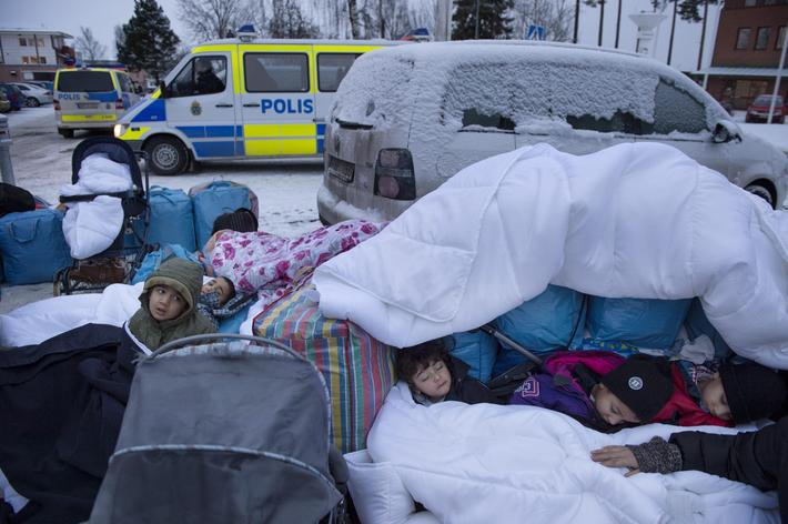Children Nor, Saleh and Hajaj Fatema from Syria sleep outside the Swedish Migration Board in Marsta,