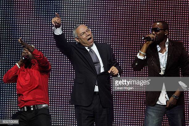 Olu Maintain and Colin Powell dancing to Yahooze [Getty Images]
