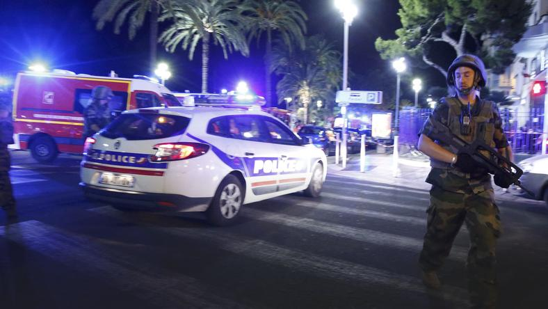 French soldiers and police secure the area after at least 30 people were killed in Nice when a truck ran into a crowd celebrating the Bastille Day national holiday