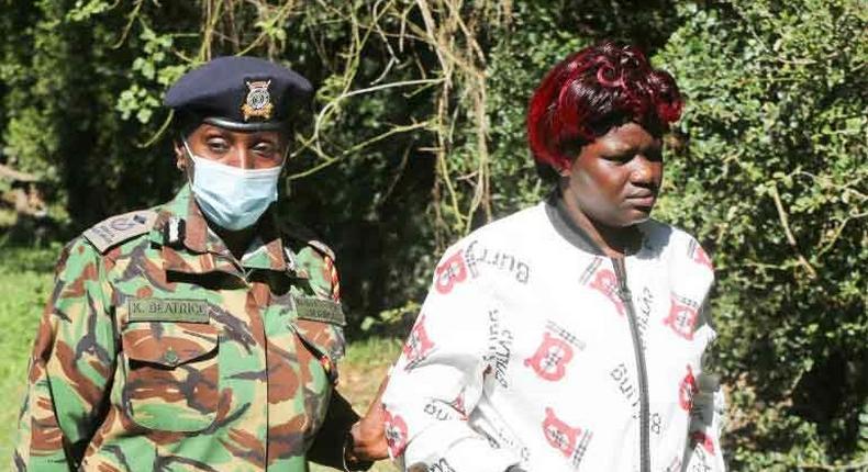 Nakuru County police commander Beatrice Kiraguri condoles Joyce Ndunge, the wife of the Late police constable Bernard Sivo at the Njoro Police station