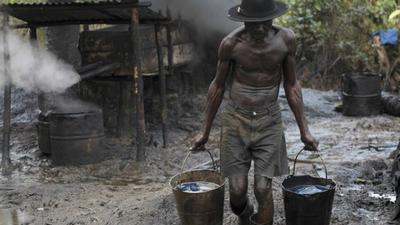 Oil companies in the Niger Delta accused of paying militants to damage pipelines