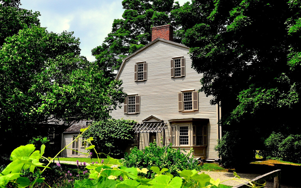 Concord, Massachusetts - July 9, 2013: 1770 Olde Manse and gardens in Minuteman National Historic Park, former home of noted American authors Ralph Waldo Emerson and Nathaniel Hawthorne *