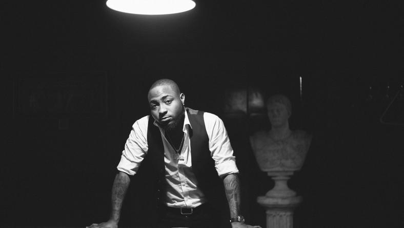 Davido leans against a pool table for his Native magazine shoot [Native]