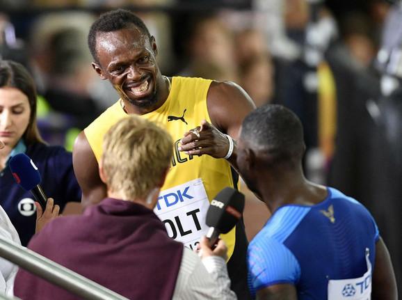 Jusein Bolt i Džastin Getlin posle finala u Londonu