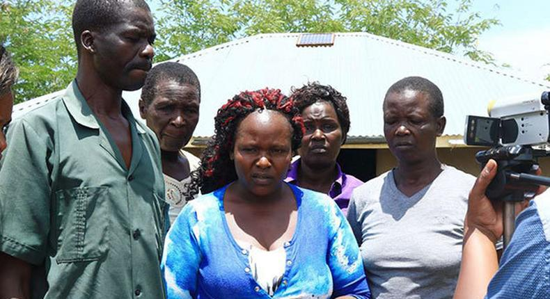 Sharon Otieno's father Douglas Otieno (left) and mother Melida Auma (centre) joined by their relatives