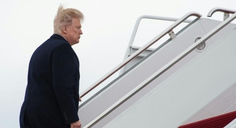 US President Donald Trump boards Air Force One at Andrews Air Force Base in Maryland on March 3, 2017 as he departs for Florida where he will spend the weekend