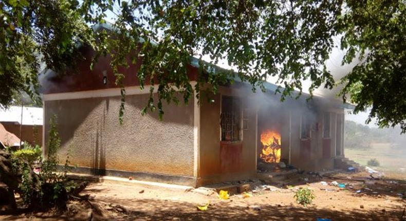 One of the houses on fire after angry residents stormed a police station after suspect's controversial death in cell