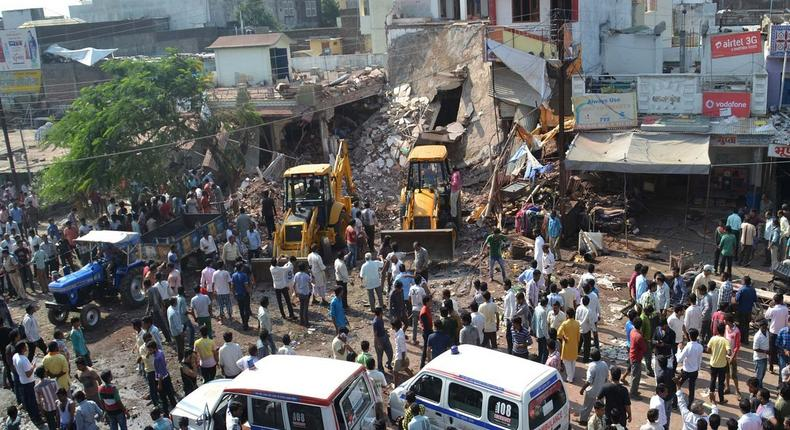 Earth movers clear debris at the site of the explosion in Petlawad, Madhya Pradesh state.
