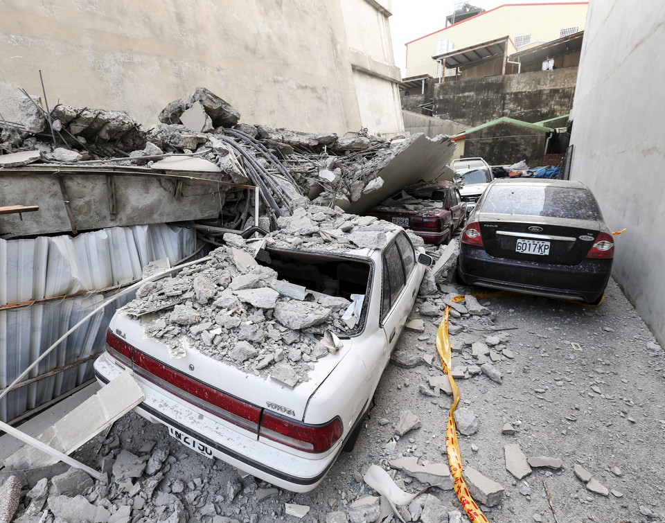 Vehicles are seen damaged after a powerful earthquake hit Tainan