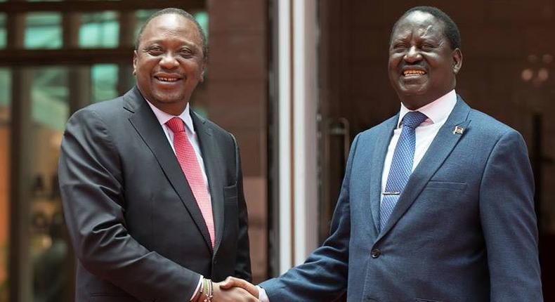 Kenya's President Uhuru Kenyatta (left) and opposition leader Raila Odinga shake hands after meeting at Harambee House, Nairobi on March 9, 2018