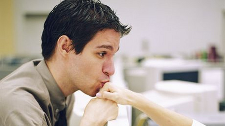Man Kissing Co-Worker's Hand --- Image by © Shannon Fagan/CORBIS