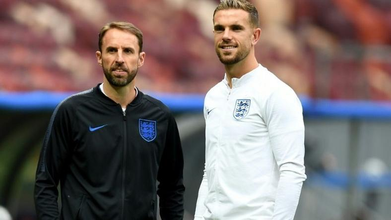 England midfielder Jordan Henderson (right) and coach Gareth Southgate inspect the pitch at the Luzhniki Stadium in Moscow ahead of their World Cup semi-final against Croatia