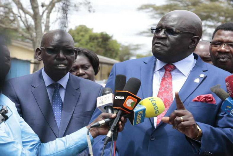 Education Cabinet Secretary George Magoha with PS Belio Kipsang