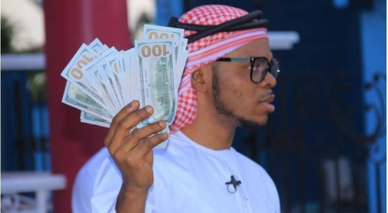 Bishop Obinim displays $100 notes as he celebrates release from police custody