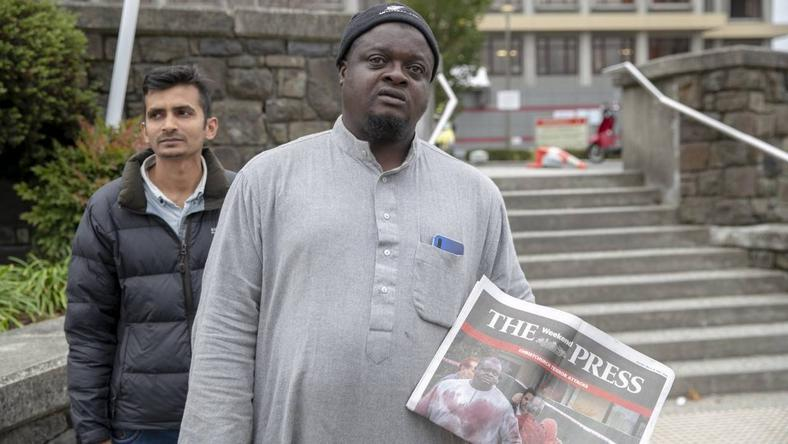 Lateef Alabi at the entrance to Christchurch hospital after attending a police briefing detailing the return of bodies to grieving families of the mosque shooting victims [Stuff]