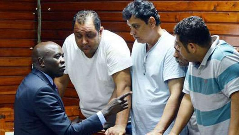 From left, lawyer Cliff Ombeta with suspects Baktash Akasha, Vijay Goswami, Gulam Hussein and Ibrahim Akasha at the Mombasa Law Courts
