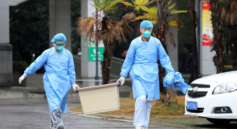 Medical staff carry a box as they walk at the Jinyintan hospital, where the patients with pneumonia caused by the new strain of coronavirus are being treated, in Wuhan (REUTERS/Stringer/File Photo CHINA OUT)