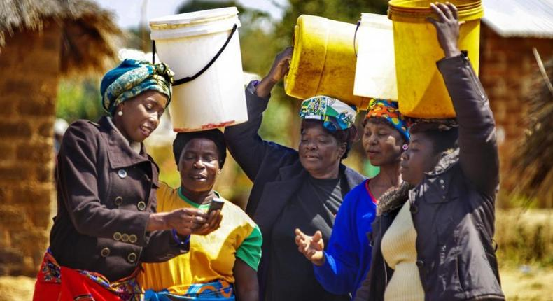 Picture of women with buckets (WHO Africa)