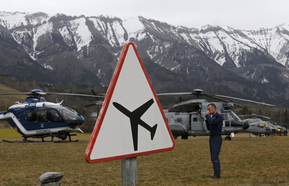 Rescue helicopters from the French Securite Civile and the Air Force are seen in front of the French Alps during a rescue operation next to the crash site of an Airbus A320