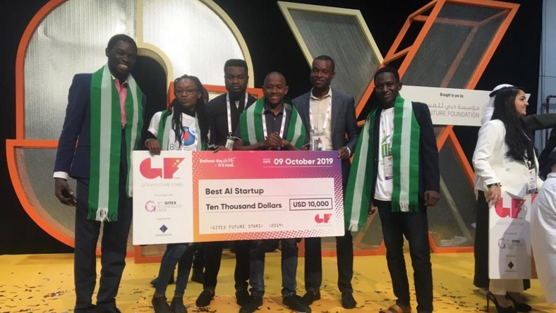 Nigerian Abdulhakim Bashir, CEO Chiniki Guard (3rd r), with his 10,000 USD prize money for winning best Artificial Intelligence category competition at GITEX holding in Dubai, UAE. Pix by NAN.
