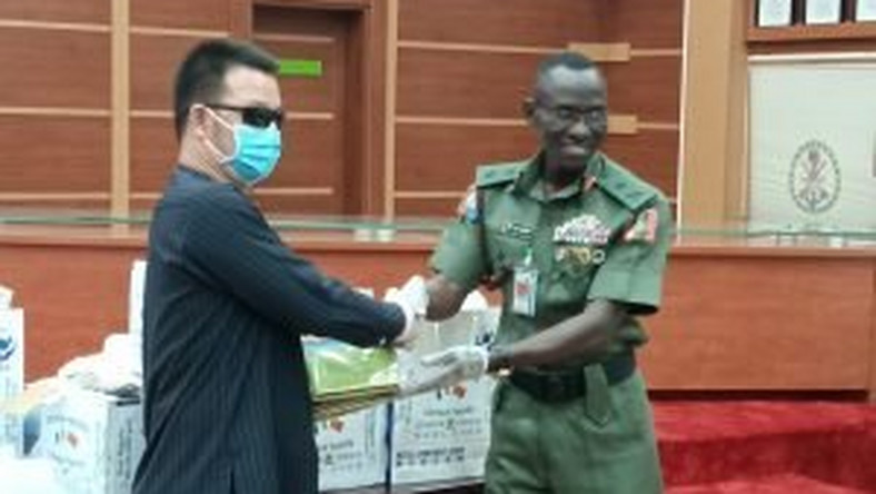 The Chief of Defence Training and Operations, Maj.-Gen. Lucky Irabor, receiving medical items donated to Defence Headquarters by the Mutual Commitment Company Ltd from its Managing Director, Mr Liu Zhao Lung in Abuja on Monday, 30/3/2020.