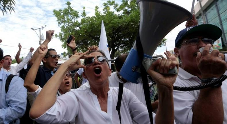 Supporters of opposition candidate Guillermo Lasso gather in front of the National Electoral Council in Guayaquil, Ecuador on April 3, 2017